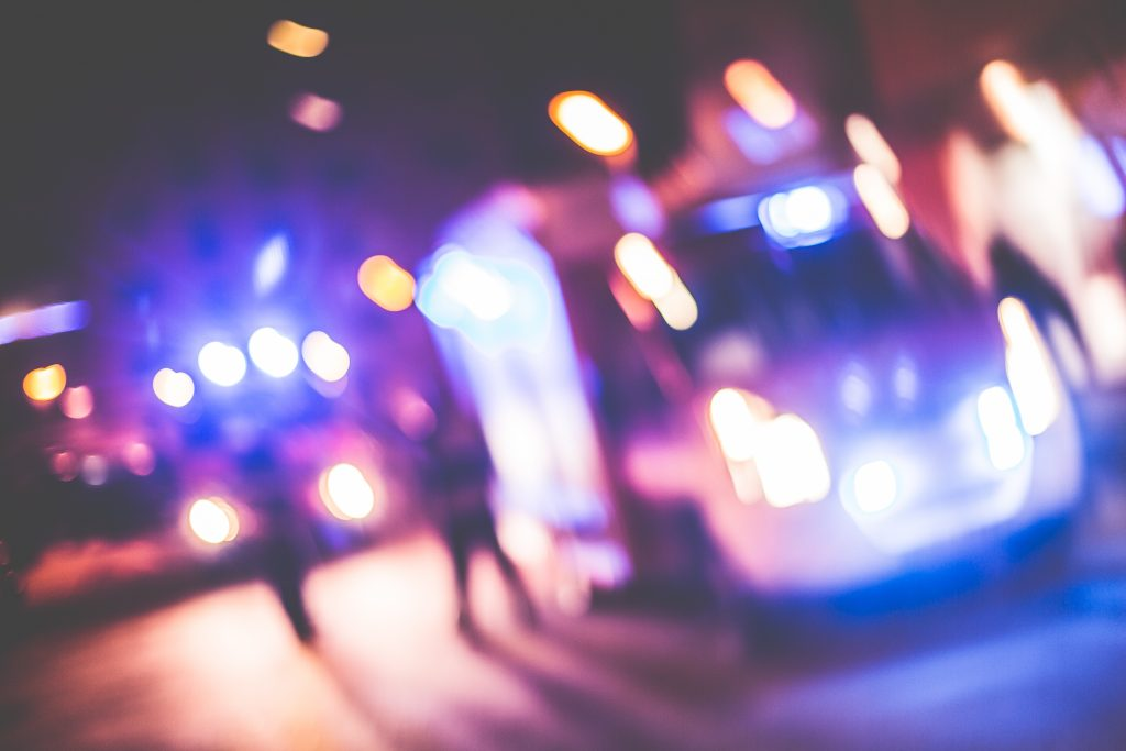 blurred-emergency-cars-at-night-picjumbo-com